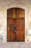 Weathered Door. A weathered door made of distressed wood with a lock royalty free stock images