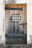 Weathered door of an old building Stock Photo