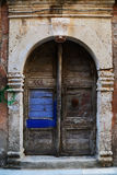 Weathered door on the old town of Chania Stock Photos