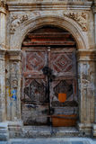 Weathered door on the old town of Chania Stock Photo