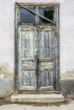 Weathered door with peeling paint. On an abandoned building Royalty Free Stock Image