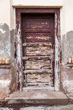 Weathered door with peeling paint Royalty Free Stock Photo