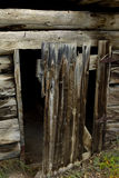 Weathered door to abandoned log cabin Stock Photos