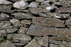 Weathered dry stone wall. Detail of weathered and moss covered dry stone wall Royalty Free Stock Photography