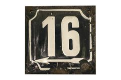 Weathered enameled plate number 16 stock image