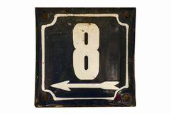 Weathered enameled plate number 8 stock photos
