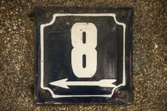 Weathered enameled plate number 8 royalty free stock image
