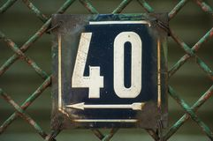 Weathered enameled plate number 40 stock photos