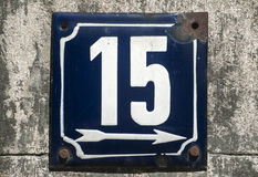 Weathered enameled plate number  15 Stock Photos