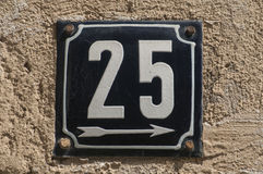 Weathered enameled plate number 25 Stock Images