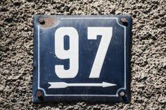 Weathered esmaltó la placa número 97 Fotos de archivo libres de regalías