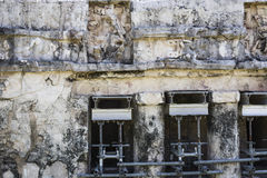 The weathered exterior wall of the Ancient Mayan building ruins in Tulum, Mexico Stock Photography