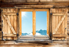 Mountain hut window shutter Stock Photography