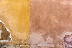 The weathered facades in yellow and beige. In closeup royalty free stock photography