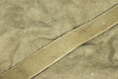 Weathered Faded Military Army  Khaki Camouflage With Belt. Backg Royalty Free Stock Photography