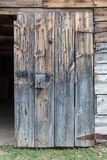 Rustic old barn wood door with rusty hinges Royalty Free Stock Image