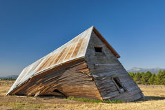 Weathered and Falling down wooden house Stock Image