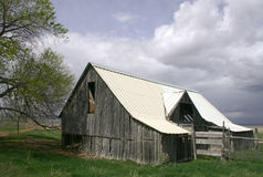 Weathered Farm Building. Old and weathered wooden farm building with metal roof in rural Utah Royalty Free Stock Photography