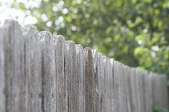 Weathered fence line. Weathered wooden fence line blurring into the distance stock photos