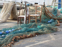 Weathered fishing nets on a traditional harbor pier in Livorno, Tuscany, Italy Royalty Free Stock Photos