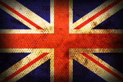 Weathered flag of United kingdom. Flag of United kingdom. Weathered burned material Stock Images