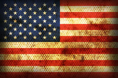 Weathered flag of  USA. Flag of  USA. Weathered burned material Stock Photo