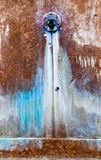 A weathered fountain. Weathered fountain with rusty colors. Orange, brown and blue. Water marks Stock Photography