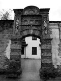 A weathered gate. A grizzled old brick gate and wall in Shanghai China Royalty Free Stock Images