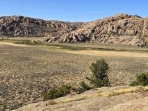 Granite rocks. Weathered granite boulders in Wyoming desert of America royalty free stock images