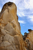 Weathered granite. Weathering and decayed granite under blue sky in Fujian, South of China, as featured geology landforms, with wonderful pattern and shape Royalty Free Stock Photos