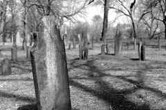 Weathered gravestones in a historic cemetery. A historic cemetery in Boston, MA royalty free stock image