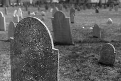 Weathered gravestones in a historic cemetery. In Boston, MA royalty free stock photo