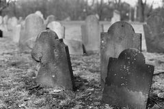 Weathered gravestones in a historic cemetery. In Boston, MA stock photography
