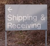 A metal sign stating `Shipping & Receiving` Stock Images