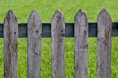Weathered gray wood picket fence Stock Photo