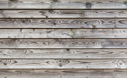 Weathered gray wooden lining boards Stock Images