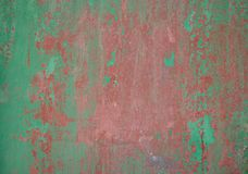 Weathered green red painted wall background partly faded. Weathered green red painted wall background, paint partially faded royalty free stock photos