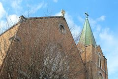 Weathered green steeple above an old brick church Royalty Free Stock Image