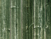 Weathered green wooden fence texture with nails. Royalty Free Stock Photo