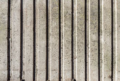 Weathered Grey Concrete Wall For Background. Weathered and stained grey concrete wall with vertical pattern for background stock photos