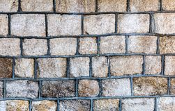 Weathered grey stone wall as background texture royalty free stock photo
