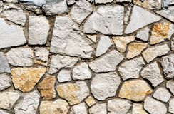 Weathered grey stone wall as creative background texture stock photography