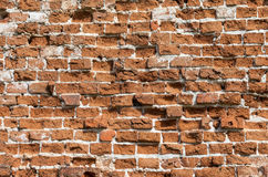 Weathered grunge red brick wall as background Stock Photos