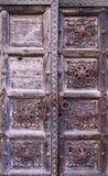 Weathered grunge wooden door texture Stock Images