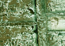 Weathered grungy painted wooden wall texture. Royalty Free Stock Images