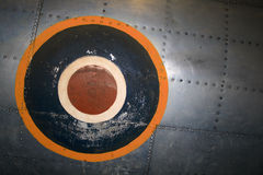 Weathered insignia on plane. Background of weathered metal plate and insignia on a Supermarine Spitfire F VIII Great Britain Fighter  bomber, Military Museum Royalty Free Stock Images