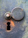 Weathered Keyhole. Old keyhole covered with rust and moos Stock Images