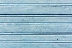 Weathered light blue hangar wall. Stock Photos