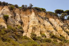 Weathered limestone rocks on the southwest coast of Spain Stock Images
