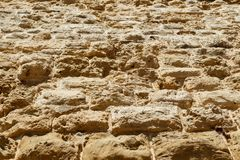 Weathered Limestone texture background, blocks make the huge stone walls of the castle of Fort. Weathered Limestone texture background, blocks make huge stone stock photos